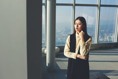 Young female Chinese model is waiting beginning of fashion shooting. Japanese businesswoman is thinking about results of meetings with international partners stock image