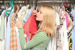 Young female choosing clothes royalty free stock image