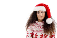Young female with christmas hat looking upward Stock Images