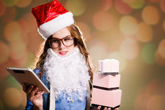 Young female in Christmas hat with presents and Stock Images