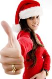 Young female with christmas hat showing thumb up Stock Images