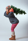 Young female with a Christmas tree Royalty Free Stock Photo