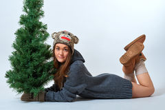 Young female with a christmas tree. Young female holding a christmas tree Royalty Free Stock Photo