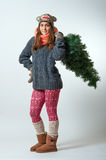 Young female with a Christmas tree Stock Photography