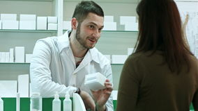 Young female cient come to pharmacy to return tablets