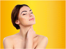Young female and clean fresh skin. The reinforcement with gold thread Royalty Free Stock Photo