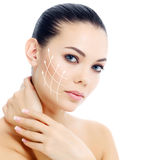 Young female with clean fresh skin. White background stock image