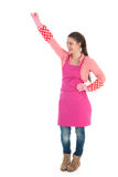 Young female cleaner with gloves and apron Royalty Free Stock Images