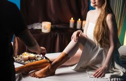Young female client getting spa treatment in rejuvenation clinic. Mud therapy. Young woman getting spa treatment in healthcare clinic. Beautiful girl with loose stock photos