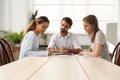 Young female client or vacancy candidate putting signature on contract royalty free stock photos