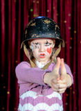 Young Female Clown Making Gun Out of Clasped Hands Stock Photos