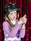 Young Female Clown Making Gun Out of Clasped Hands Royalty Free Stock Photo