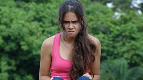Youngster And Anger. A young female Colombian teen Royalty Free Stock Photos