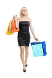 A young female coming back from shopping Stock Photography
