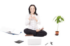 Young female company worker with laptop in lotus pose on white b Stock Image