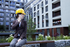 Young female construction engineer with phone Stock Photos