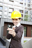 Young female construction engineer pointing Stock Photography