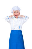 Young female cook in panic Royalty Free Stock Images