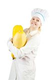 Young female cook with  vegetables Royalty Free Stock Photos