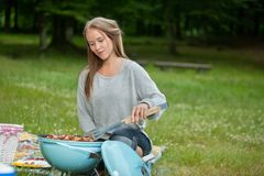 Young Female Cooking Food On Barbecue Stock Images