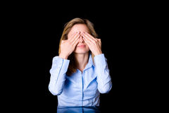Young female covers her eyes, fear or surprise Stock Photo