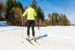 Young female cross country skiing. Royalty Free Stock Photography