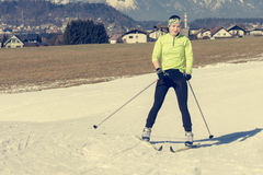 Young female cross country skiing. Stock Photos