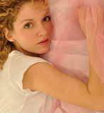 Young female with curly hair and big eyes Royalty Free Stock Image