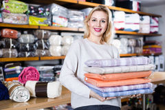 Young female customer boasting purchased home textiles Stock Photography