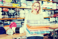 Young female customer boasting purchased home textiles Stock Photo