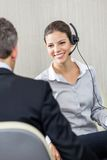 Young Female Customer Service Executive Looking At Stock Photos