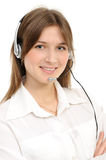 Young female customer service representative. In headset, smiling  on a white background Stock Photos