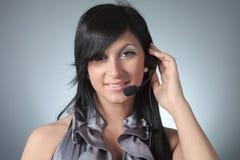 Young female customer service representative in Stock Image