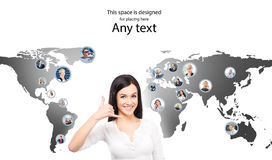 Young female customer support operator on a world map Royalty Free Stock Photography