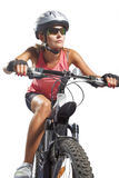 Young female cycling athlete riding mountain bike and equipped w Royalty Free Stock Images