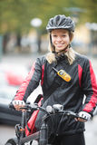 Young Female Cyclist With Courier Delivery Bag Royalty Free Stock Photo