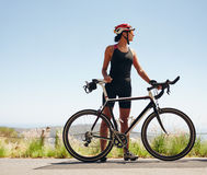 Young female cyclist looking away Royalty Free Stock Images