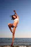 Young female dancer on the beach Stock Images