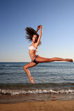 Young female dancer on the beach Stock Photography