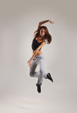 A young female dancer jumping in sporty clothes Stock Photo