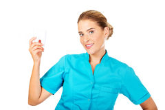 Young female dentist holding tooth model Royalty Free Stock Photos