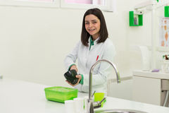 Young Female Dentist Working On The Mould Stock Photos