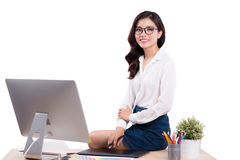 Young female designer sitting at desk while working with compute. R Stock Photography