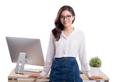 Young female designer sitting at desk while working with compute. R Stock Photo
