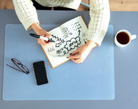 Young female designer using graphics tablet while Royalty Free Stock Images