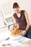 Young female designer with wooden color swatches stock photography