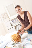 Young female designer with wooden color swatches Stock Image