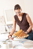Young female designer with wooden color swatches Royalty Free Stock Photo