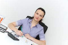 Young female designer working with architectural plan Royalty Free Stock Photography