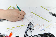 Young female designer working with architectural plan Stock Images